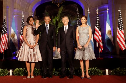President Barack Obama waves as he poses for photos with Argentine President Mauricio Macri, first lady Michelle, left, and Argentine first lady Juliana Awada before a state dinner in Buenos Aires, Argentina, Wednesday, March 23, 2016. (AP Photo/Victor R. Caivano)